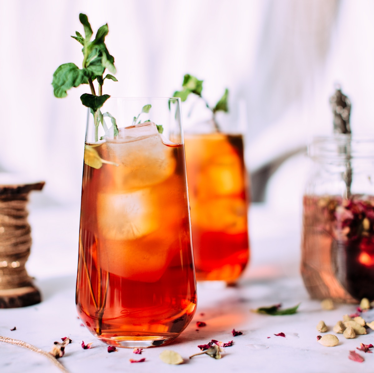 glass of iced tea with a sprig of mint