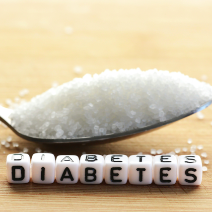 a spoonful of white sugar and the words diabetes